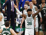Boston Celtics' Marcus Smart celebrates after being fouled by Milwaukee Bucks' Giannis Antetokounmpo during the fourth quarter of an NBA basketball game Wednesday, Oct. 30, 2019, in Boston. (AP Photo/Winslow Townson)
