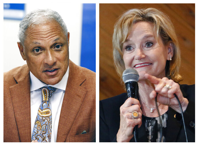 This combination photo shows Mike Espy, left, a former congressman and former U.S. agriculture secretary, on Oct. 5, 2018, and U.S. Sen. Cindy Hyde-Smith, R-Miss., on Nov. 5, 2018, both in Jackson, Miss. Mike Espy a Democrat who tried to unseat Republican U.S. Sen. Cindy Hyde-Smith in Mississippi last year is seeking money to challenge her again in 2020. (AP Photo/Rogelio V. Solis, File)