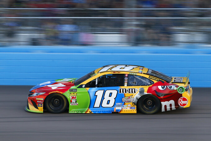 Kyle Busch drives during the NASCAR Cup Series auto race at ISM Raceway, Sunday, Nov. 10, 2019, in Avondale, Ariz. (AP Photo/Ralph Freso)