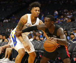Miami Heat guard Kendrick Nunn, right, drives against Golden State Warriors guard Malachi Richardson during the first half of an NBA basketball summer league game in Sacramento, Calif., Wednesday, July 3, 2019. The Heat won 73-65. (AP Photo/Rich Pedroncelli)