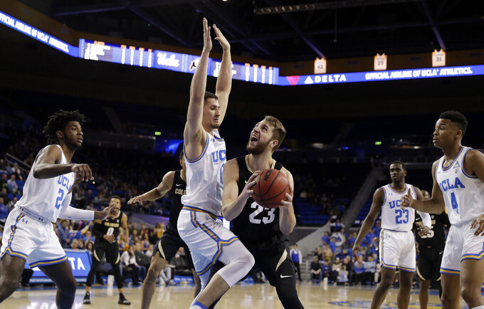 Colorado forward Lucas Siewert, center right, is defended by UCLA forward Alex Olesinski, center left, during the first half of an NCAA college basketball game Wednesday, Feb. 6, 2019, in Los Angeles. (AP Photo/Marcio Jose Sanchez)