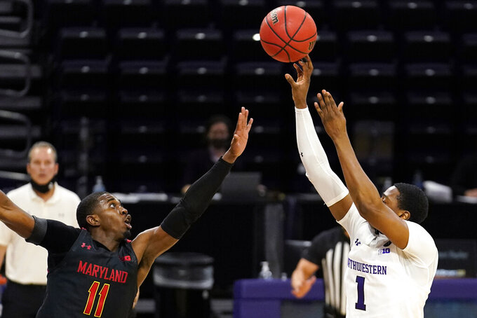 Northwestern guard Chase Audige, right, shoots over Maryland guard Darryl Morsell during the second half of an NCAA college basketball game in Evanston, Ill., Wednesday, March 3, 2021. Northwestern won 60-55.(AP Photo/Nam Y. Huh)