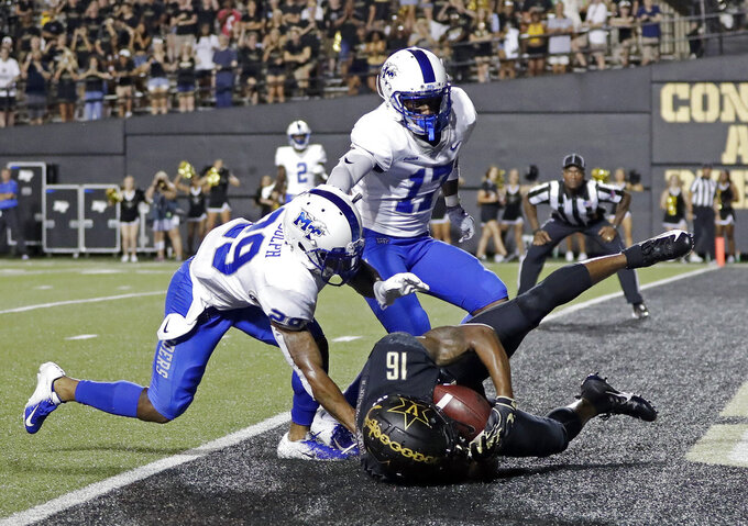 Vanderbilt wide receiver Kalija Lipscomb (16) catches a touchdown pass as he is defended by Middle Tennessee's Darryl Randolph (29) and Kylan Stribling (17) in the second half of an NCAA college football game Saturday, Sept. 1, 2018, in Nashville, Tenn. Vanderbilt won 35-7. (AP Photo/Mark Humphrey)