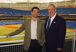 FILE - In this May 13, 2014, file photo, new Tampa Bay Devil Rays general partner Stuart Sternberg, left, poses with managing general partner Vince Naimoli before the start of the Devil Rays game with the Texas Rangers St. Petersburg, Fla.  Original Tampa Bay Rays owner Vince Naimoli has died at 81. The team said Monday, Aug. 26, 2019, he died Sunday nearly five years after being diagnosed with an uncommon brain disorder. (AP Photo/Chris O'Meara, File)