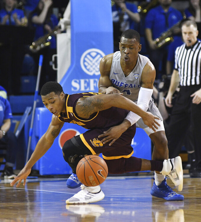 Buffalo's Davonta Jordan, right, steals the ball from Central Michigan's Shawn Roundtree, Jr., during an NCAA college basketball game in Buffalo, N.Y., Saturday, Feb. 9, 2019. (AP Photo/Heather Ainsworth)