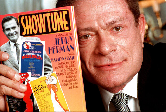 FILE - In this Nov. 19, 1996, file photo, composer Jerry Herman displays his book