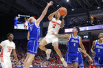 Dayton's Ibi Watson (2) shoots against Drake's Antonio Pilipovic (11) and Anthony Murphy (4) during the first half of an NCAA college basketball game, Saturday, Dec. 14, 2019, in Dayton, Ohio. (AP Photo/John Minchillo)