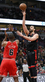 Toronto Raptors' Marc Gasol, right, of Spain, goes up for a shot against Chicago Bulls' Christiano Felicio, left, of Brazil, during the first half of an NBA basketball game, Saturday, March 30, 2019, in Chicago. (AP Photo/Paul Beaty)