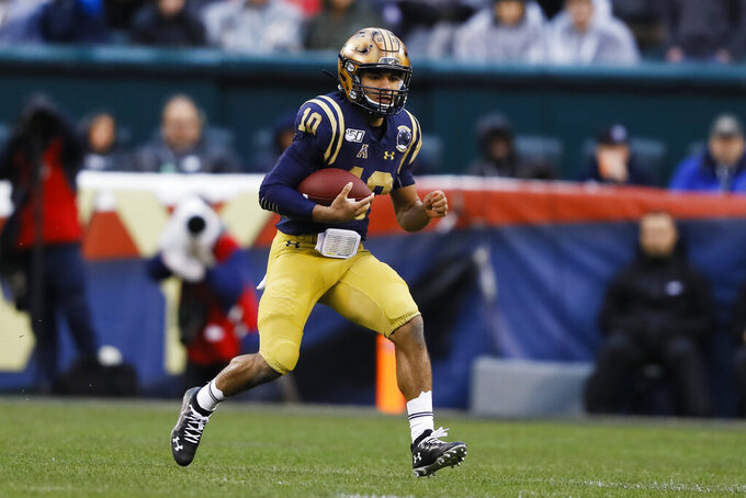 Navy quarterback Malcolm Perry run the ball during the first half of an NCAA college football game against Army, Saturday, Dec. 14, 2019, in Philadelphia. (AP Photo/Matt Slocum)