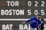 Toronto Blue Jays' Lourdes Gurriel Jr. makes the catch on a flyout by Boston Red Sox's Sandy Leon during the fourth inning of a baseball game in Boston, Monday, July 15, 2019. (AP Photo/Michael Dwyer)