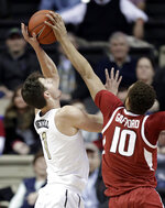 Arkansas forward Daniel Gafford (10) blocks a shot by Vanderbilt forward Yanni Wetzell (1) in the first half of an NCAA college basketball game Wednesday, March 6, 2019, in Nashville, Tenn. (AP Photo/Mark Humphrey)