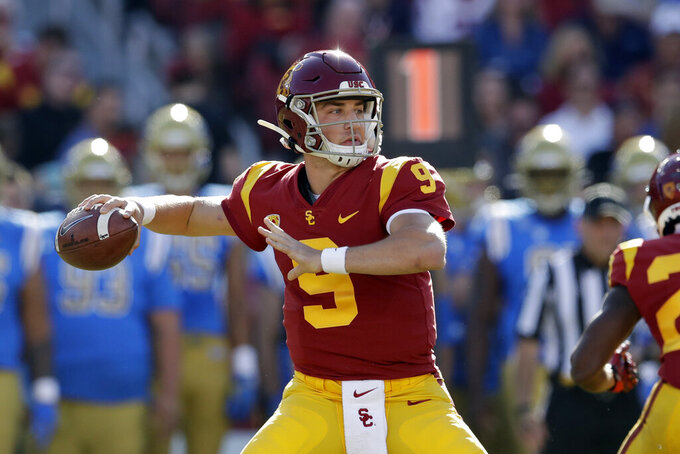 FILE - In this Nov. 23, 2019, file photo, Southern California quarterback Kedon Slovis throws against UCLA during the first half of an NCAA college football game, in Los Angeles. Slovis was selected as The Associated Press Pac 12 Conference team Newcomer of the Year, Thursday, Dec. 12, 2019.(AP Photo/Marcio Jose Sanchez, File)