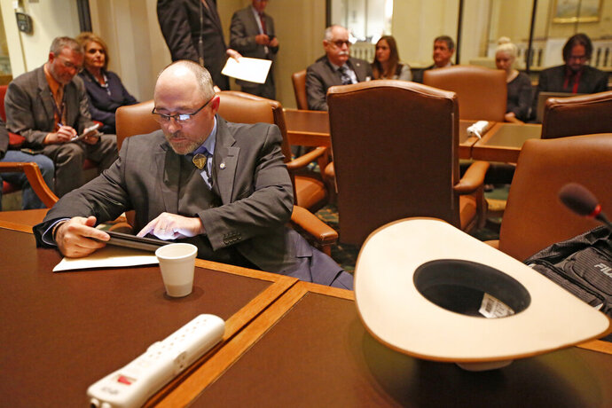 FILE - In this Feb. 14, 2017, file photo, Oklahoma State Rep. Justin Humphrey prepares to speak at the State Capitol in Oklahoma City. A mythical, ape-like creature that has captured the imagination of adventurers for decades has now become the target of Rep. Justin Humphrey. Humphrey, a Republican House member has introduced a bill that would create a Bigfoot hunting season, He says issuing a state hunting license and tag could help boost tourism.  (Steve Gooch/The Oklahoman via AP, File)