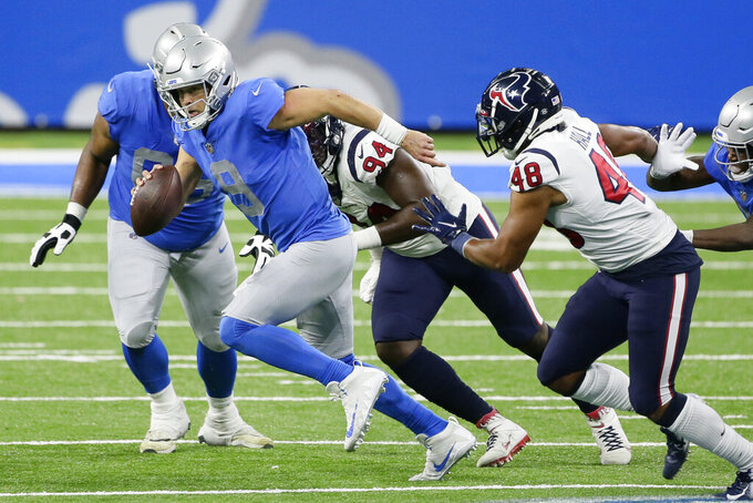Detroit Lions quarterback Matthew Stafford (9) scrambles during the second half of an NFL football game against the Houston Texans, Thursday, Nov. 26, 2020, in Detroit. (AP Photo/Duane Burleson)