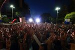 Supporters of the Democratic Party-led opposition gather during a rally in Tirana, Monday, July 8, 2019. Albania's opposition parties have resumed holding anti-government protests after their boycott of June 30 municipal elections. (AP Photo/Hektor Pustina)