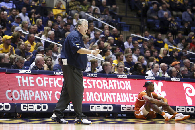 West Virginia coach Bob Huggins reacts to a call during the first half of an NCAA college basketball game against Texas Monday, Jan. 20, 2020, in Morgantown, W.Va. (AP Photo/Kathleen Batten)