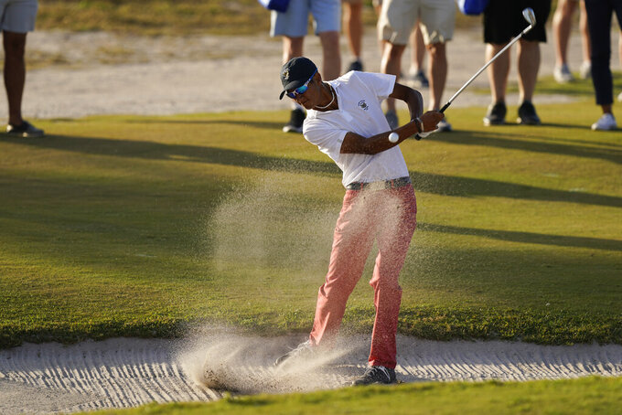 Ricky Castillo, of the USA team, hits from the bunker on the 17th hole in the singles matches during the Walker Cup golf tournament at the Seminole Golf Club on Sunday, May 9, 2021, in Juno Beach, Fla. (AP Photo/Brynn Anderson)