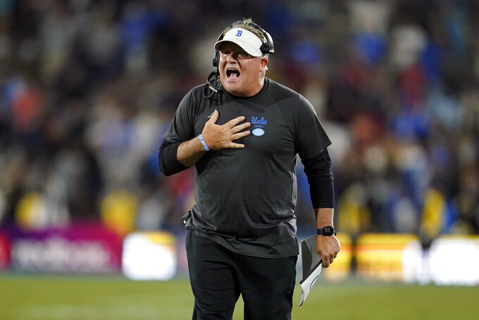 UCLA head coach Chip Kelly yells instructions at one of his players during the second half of an NCAA college football game against Fresno State Sunday, Sept. 19, 2021, in Pasadena, Calif. (AP Photo/Marcio Jose Sanchez)