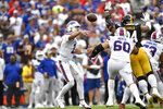 Buffalo Bills quarterback Josh Allen (17) gets off a pass under pressure by Pittsburgh Steelers defensive end Tyson Alualu (94) during the first half of an NFL football game in Orchard Park, N.Y., Sunday, Sept. 12, 2021. (AP Photo/Adrian Kraus)