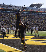 Missouri running back Damarea Crockett, top, is hoisted in the air by teammate Kevin Pendleton after he scored a touchdown during the second half of an NCAA college football game against Vanderbilt, Saturday, Nov. 10, 2018, in Columbia, Mo. (AP Photo/L.G. Patterson)