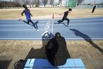 In this Feb. 12, 2020, photo, Joseph Akoon Akoon, left, of the South Sudan team and Japanese athlete Mizuki Obuchi, right, practice together during their training  for the Tokyo 2020 Olympics and Paralympics in Maebashi, Gunma Prefecture, north of Tokyo. (AP Photo/Eugene Hoshiko)