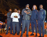 Clemson's Christian Wilkins, Adam Choice, Hunter Renfrow, Clelin Ferrell, Trevor Lawrence and Trayvon Mullen, from left, stand on a stage after the team returned to campus Tuesday, Jan. 8, 2019, in Clemson, S.C., the day after a 44-16 win over Alabama in the College Football Playoff championship game. (AP Photo/Richard Shiro)