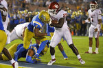 Oklahoma running back Rhamondre Stevenson, right, scores a touchdown as UCLA defensive back Stephan Blaylock defends during the second half of an NCAA college football game Saturday, Sept. 14, 2019, in Pasadena, Calif. (AP Photo/Mark J. Terrill)