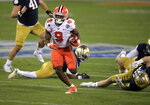 Clemson running back Travis Etienne (9) runs for a touchdown during the first half of the Atlantic Coast Conference championship NCAA college football game against Notre Dame, Saturday, Dec. 19, 2020, in Charlotte, N.C. (AP Photo/Brian Blanco)