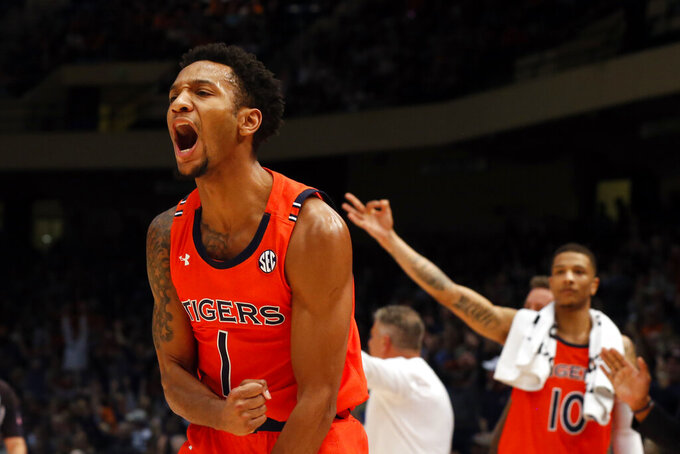 Auburn guard Jamal Johnson (1) reacts after making a three-point basket against Saint Louis during the second half of an NCAA college basketball game Saturday, Dec. 14, 2019, in Birmingham, Ala. (AP Photo/Butch Dill)