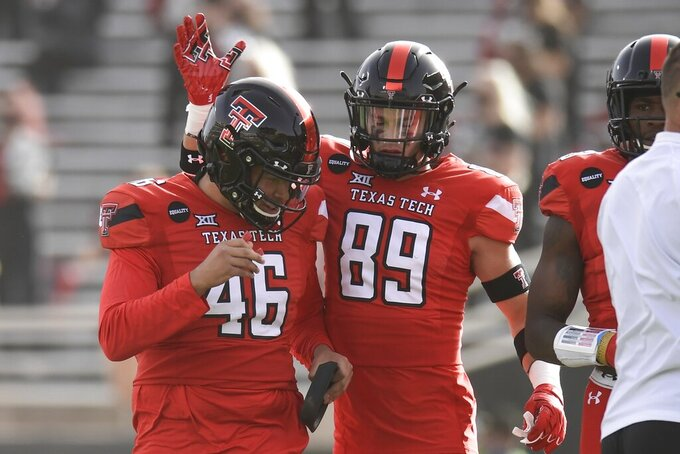 Texas Tech wide receiver Caden Leggett (89) congratulates placekicker Jonathan Garibay (46) after a kicking a field goal in the first half of an NCAA college football game in Lubbock, Texas, Saturday, Nov. 14, 2020. (AP Photo/Justin Rex)
