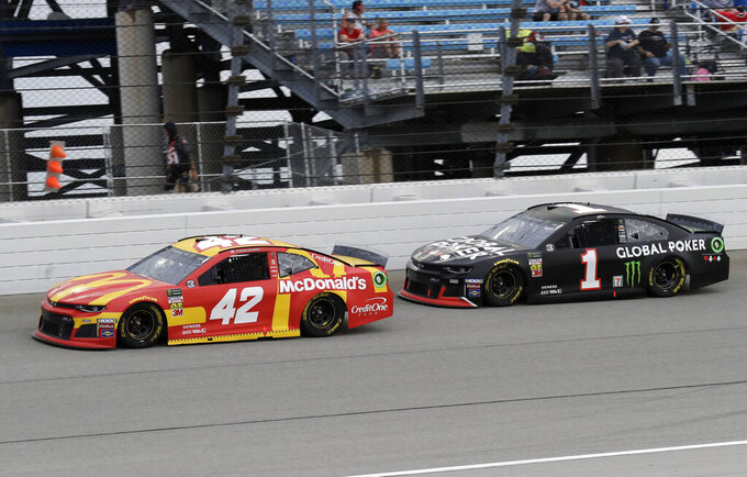 Kyle Larson, left, and Kurt Busch compete during a NASCAR Cup Series auto race at Chicagoland Speedway in Joliet, Ill., Sunday, June 30, 2019. (AP Photo/Nam Y. Huh)