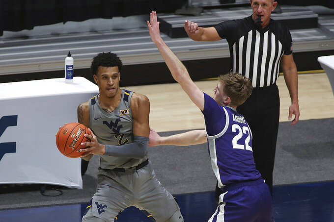 West Virginia forward Jalen Bridges (2) is defended by Kansas State guard Luke Kasubke (22) during the second half of an NCAA college basketball game Saturday, Feb. 27, 2021, in Morgantown, W.Va. (AP Photo/Kathleen Batten)