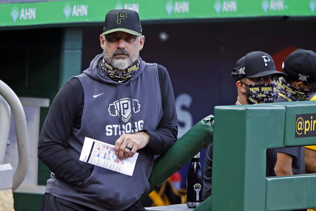 Pittsburgh Pirates manager Derek Shelton, left, stands on the dugout steps during the team's intrasquad baseball game at PNC Park in Pittsburgh, Monday, July 13, 2020. (AP Photo/Gene J. Puskar)