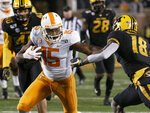 Tennessee wide receiver Jauan Jennings, left, pushes past Missouri safety Joshuah Bledsoe on the way to a touchdown during the second quarter of an NCAA college football game Saturday, Nov. 23, 2019, in Columbia, Mo. (AP Photo/L.G. Patterson)