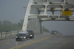 A hearse carrying the casket of the late Rep. John Lewis, D-Ga., drives over the Edmund Pettus Bridge Saturday, July 25, 2020, in route to the Brown Chapel in Selma, Ala. Lewis, who carried the struggle against racial discrimination from Southern battlegrounds of the 1960s to the halls of Congress, died Friday, July 17, 2020. (AP Photo/Brynn Anderson)