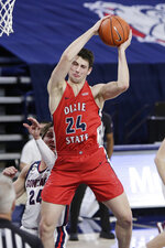 Dixie State forward Jacob Nicolds grabs a rebound during the first half of an NCAA college basketball game against Gonzaga in Spokane, Wash., Tuesday, Dec. 29, 2020. (AP Photo/Young Kwak)