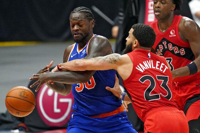 Toronto Raptors guard Fred VanVleet (23) knocks the ball away from New York Knicks forward Julius Randle (30) during the second half of an NBA basketball game Thursday, Dec. 31, 2020, in Tampa, Fla. (AP Photo/Chris O'Meara)