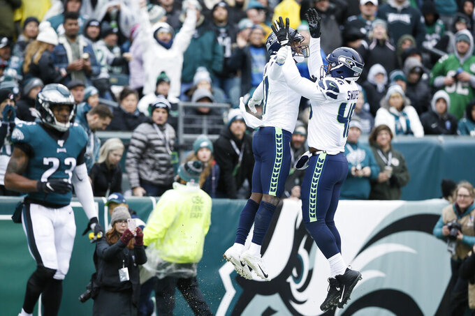 Seattle Seahawks' Malik Turner (17) and Tyrone Swoopes (46) celebrate after a touchdown by Turner during the first half of an NFL football game against the Philadelphia Eagles, Sunday, Nov. 24, 2019, in Philadelphia. (AP Photo/Michael Perez)