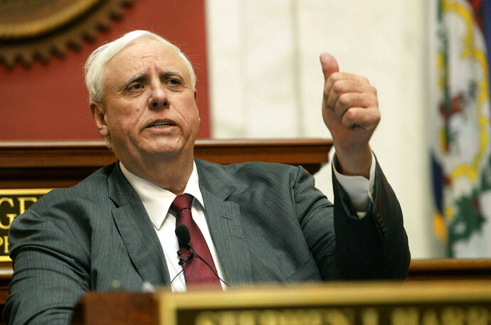 FILE - In this Jan. 9, 2019, file photo West Virginia Gov. Jim Justice delivers his State of the State address in the House of Delegates' Chamber in Charleston, W.Va. A family business of West Virginia's billionaire governor has maxed out a taxpayer-funded subsidy program meant to help farmers through the U.S. trade war with China. Records reviewed by The Associated Press show Justice Farms of North Carolina took in tens of thousands of taxpayer dollars from the program earlier this year.  (Chris Dorst/Charleston Gazette-Mail via AP, File)