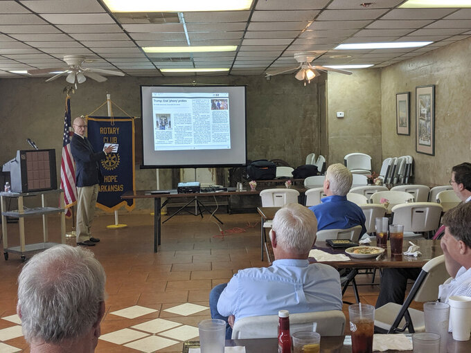 """In this Thursday, May 23, 2019 file photo, Walter Hussman Jr., publisher of the statewide newspaper the Arkansas Democrat-Gazette, explains to members of the Hope, Arkansas Rotary Club how to access and use the paper's digital replica on an iPad in Hope, Ark. Walter Hussman Jr. a major University of North Carolina donor said Wednesday, June 2, 2021 that he sent emails to university officials questioning the hiring of Nikole Hannah-Jones after he became concerned about how much research went into the selection of the investigative journalist, whose award-winning work on slavery he called """"highly contentious and highly controversial.""""  (AP Photo/Hannah Grabenstein)"""