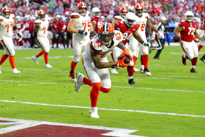 Cleveland Browns tight end Ricky Seals-Jones (83) scores a touchdown against the Arizona Cardinals during the second half of an NFL football game, Sunday, Dec. 15, 2019, in Glendale, Ariz. (AP Photo/Rick Scuteri)