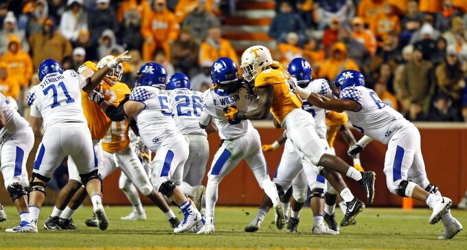 Kentucky quarterback Terry Wilson (3) is hit from behind by Tennessee linebacker Darrell Taylor (19) in the second half of an NCAA college football game Saturday, Nov. 10, 2018, in Knoxville, Tenn. Tennessee won 24-7. (AP Photo/Wade Payne)