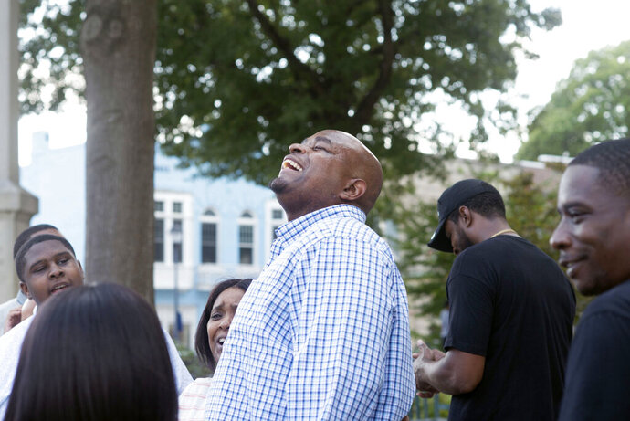 Dontae Sharpe breathes the air outside the Pitt County Courthouse after a judge determined he could be set free, Thursday, Aug. 22, 2019 in Greenville, N.C. Sharpe, a North Carolina man who maintained his innocence even as he served a life sentence for a murder he didn't commit said Thursday that he got his strength in prison from God and his mother. (Deborah Griffin/The Daily Reflector via AP)