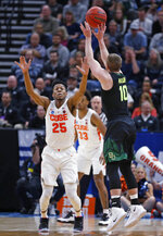 Baylor guard Makai Mason (10) shoots as Syracuse guard Tyus Battle (25) defends during the first half of a first-round game in the NCAA men's college basketball tournament Thursday, March 21, 2019, in Salt Lake City. (AP Photo/Rick Bowmer)