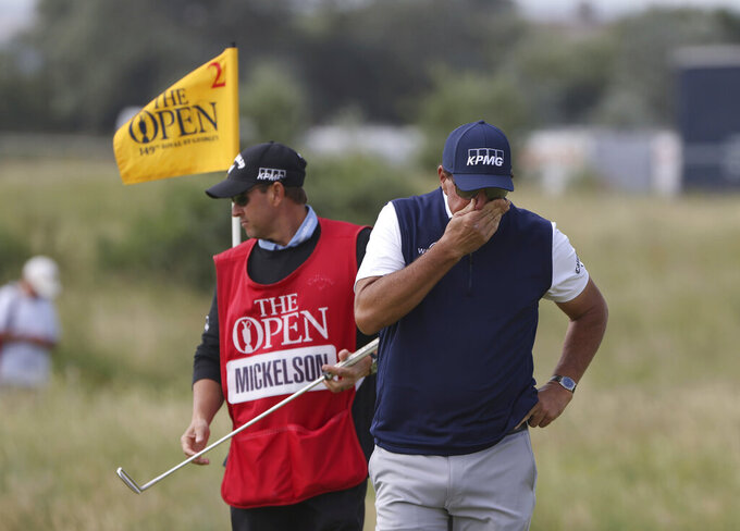 United States' Phil Mickelson reacts to his putting on the 2nd green during the second round of the British Open Golf Championship at Royal St George's golf course Sandwich, England, Friday, July 16, 2021. (AP Photo/Ian Walton)
