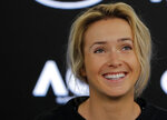 Ukraine's Elina Svitolina smiles during a press conference at the Australian Open tennis championships in Melbourne, Australia, Saturday, Jan. 13, 2018. (AP Photo/Vincent Thian)