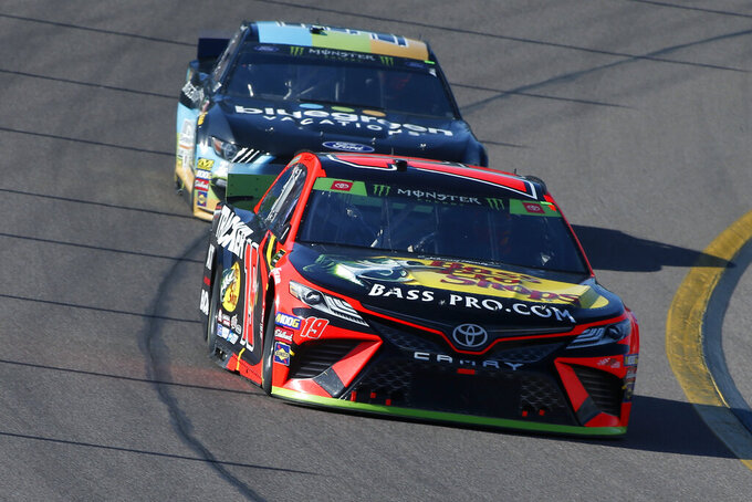 Martin Truex Jr. (19) drives during the NASCAR Cup Series auto race at ISM Raceway, Sunday, Nov. 10, 2019, in Avondale, Ariz. (AP Photo/Ralph Freso)