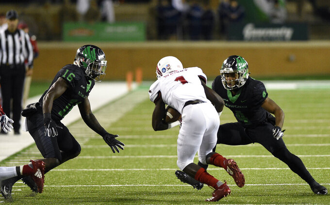 North Texas safety Khairi Muhammad (4) and North Texas defensive back Kemon Hall (16) close in on Florida Atlantic wide receiver Willie Wright (1) during the first half of an NCAA college football game, Thursday, Nov. 15, 2018 in Denton, Texas. (Jake King/The Denton Record-Chronicle via AP)