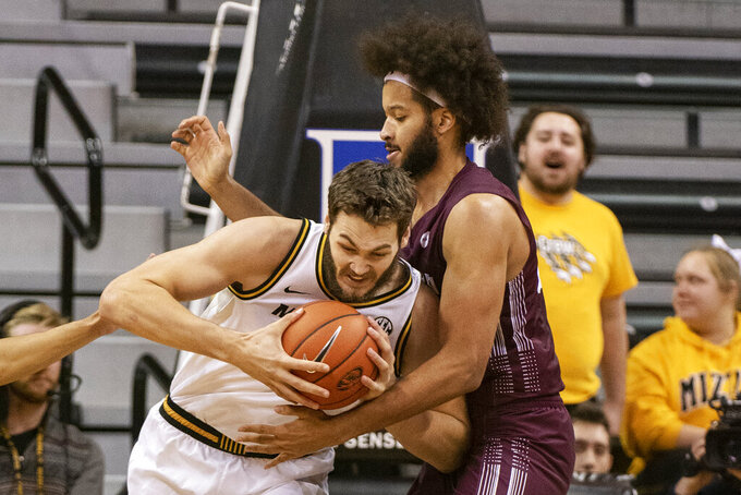 Missouri's Reed Nikko, left, pushes his way past Southern Illinois' Barret Benson, right, during the first half of an NCAA college basketball game Sunday, Dec. 15, 2019, in Columbia, Mo. (AP Photo/L.G. Patterson)