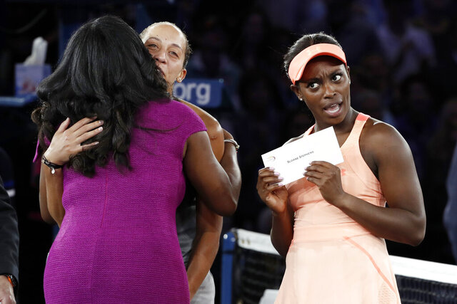 FILE - In this Sept. 9, 2017, file photo, Sloane Stephens, of the United States, reacts after receiving the winner's award check after beating Madison Keys, of the United States, in the women's singles final at the U.S. Open tennis tournament in New York. Despite a loss in revenue from holding its marquee event without spectators amid the coronavirus pandemic, the U.S. Tennis Association announced Wednesday, Aug. 5, 2020, that its overall compensation to players at this year's U.S. Open will be $53.4 million -- which is 93.3% of the roughly $57.2 million awarded in 2019.  (AP Photo/Andres Kudacki)